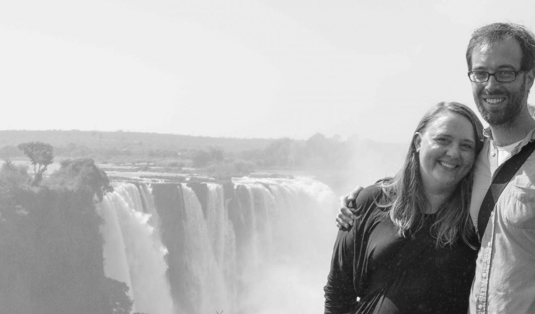 Husband and wife in front of Victoria Falls
